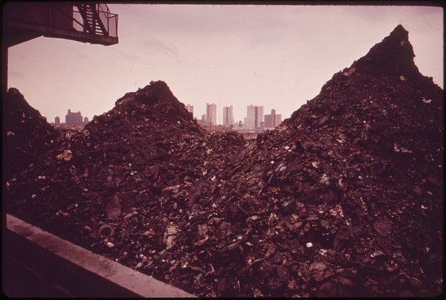 A barge carrying incineration waste to be dumped at sea (New York, 1973). © Arthur Tress / U.S. National Archives