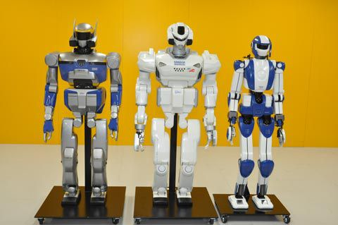 Three Japanese android (or anthropoid) robots designed at the AIST (Advanced Industrial Science and Technology). From left to right: HRP-2 (2003), HRP-3 (2007) and HRP-4 (2010). © AIST