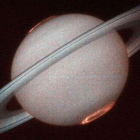 Saturn, photographed from terrestrial orbit by the Hubble space telescope showing the polar auroras.