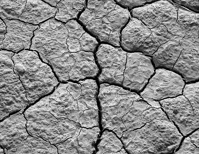 Droughts cause soil to crack. © BalouLumix CC by-nc-nd 3.0