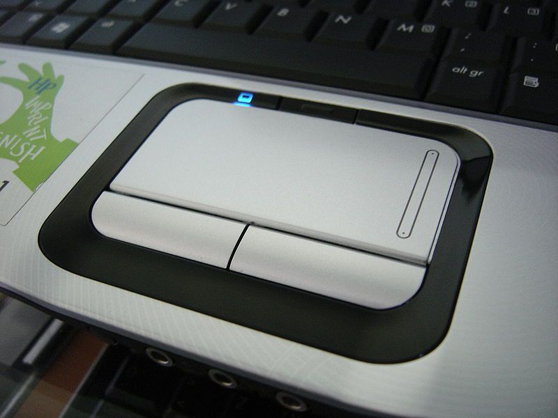A touchpad on a laptop. © HP