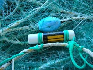 A pressure and temperature sensor mounted on a fishing net for the Ifremer Recopesca operation. © Ifremer/STH