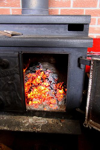 A wood stove used to heat a home. © BevKnits CC by-nc-nd 2.0