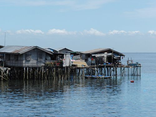This village on stilts beside a lake is a riparian village. © burgermac CC by 2.0