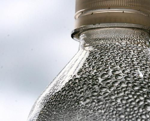 Water is not just used to quench thirst. The production of food, products (such as this bottle) and services consume large quantities of water. This consumption is expressed in the form of virtual water because the water used is usually not present in the final products. © Muffet CC by 2.0