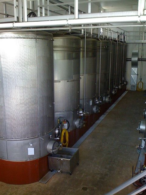 These fermentation reactors contain bacteria that convert grape sugar into alcohol in order to produce wine. © Kyle L. CC by-nd 2.0