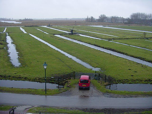 An agricultural polder such as can be found in the Netherlands. Canals and mills can be seen continually draining the water from these wet zones. © Edward MacGregor CC by-nc-nd 3.0