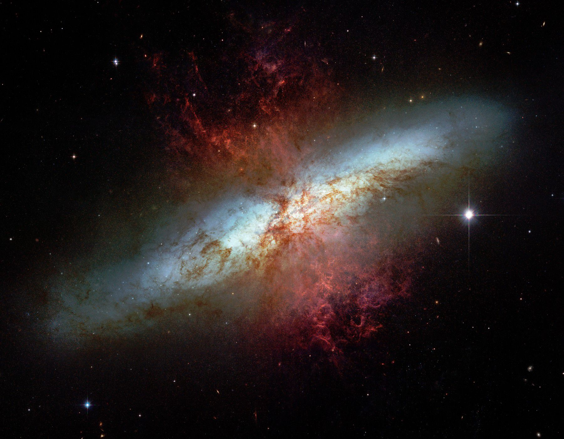 This extraordinary photo taken by the Hubble space telescope shows the irregularities at the heart of M82. Credit NASA