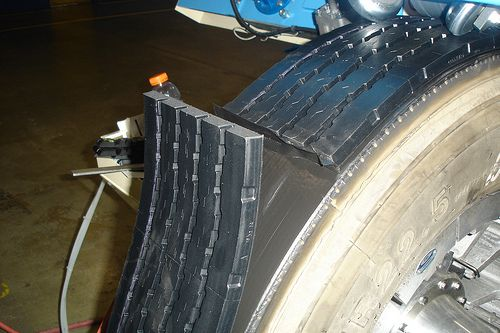Placing a new tread on a used tire. © TruckPR CC by-nc-nd 2.0