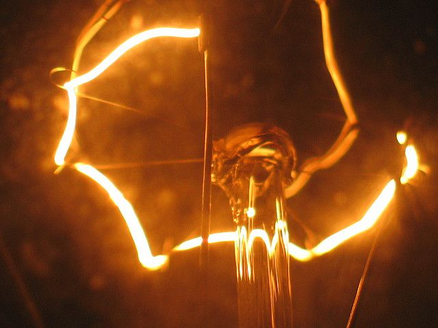 The incandescent filament of this light bulb is emitting yellow light. © Feghoul Fawzi CC by-nc-nd 2.0